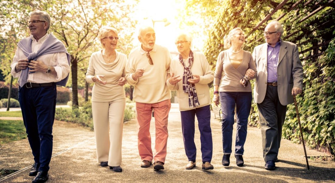 Group of old people walking outdoors. Ageing population concept