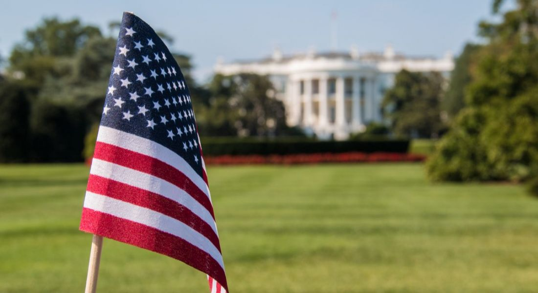 American flag waving in front of White House