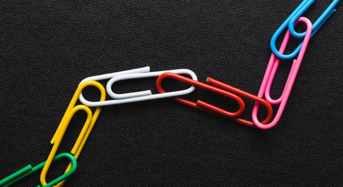 Colourful paperclips joined together to represent blockchain