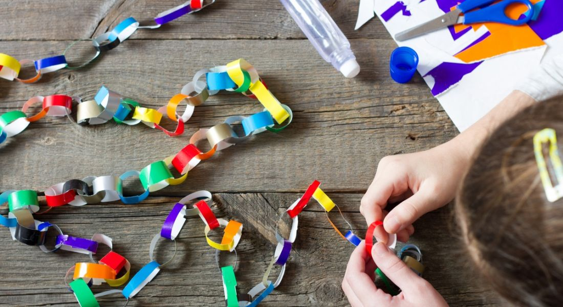 Colourful paper chain being built blockchain concept