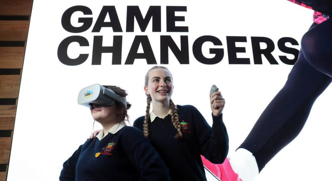 From left: Students Melody McGuirk and Michaela Doran demonstrating a VR headset.