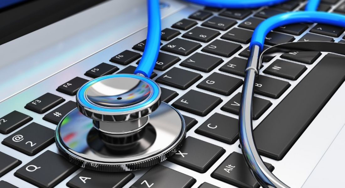 Picture of a stethoscope on a computer keyboard.