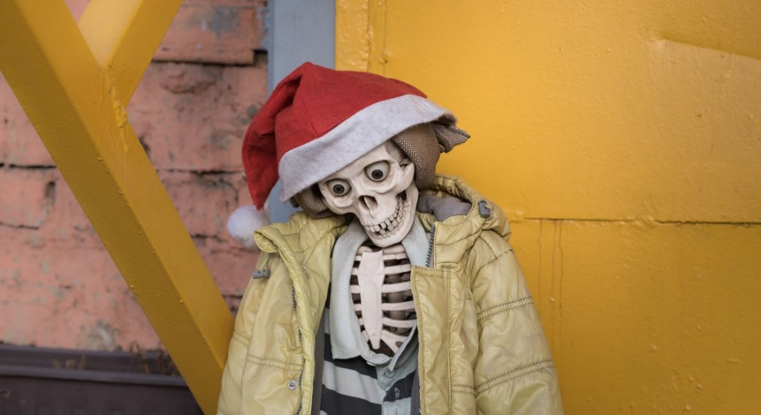 A skeleton in a yellow puffa jacket and Santa had propped against a wall.