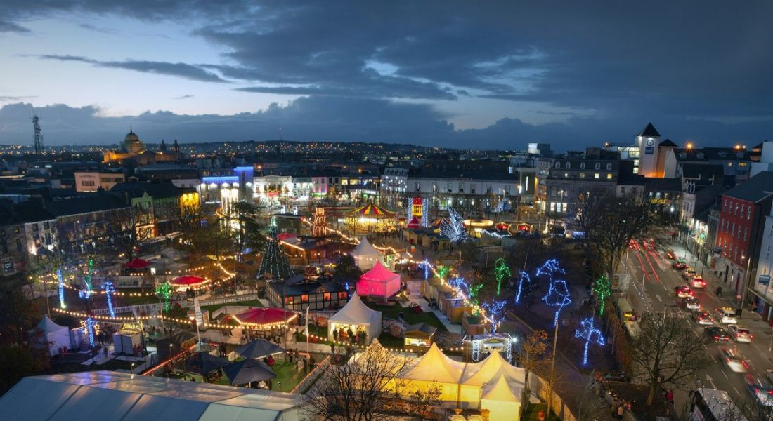 Panoramic view of Galway Continental Christmas Market at night.