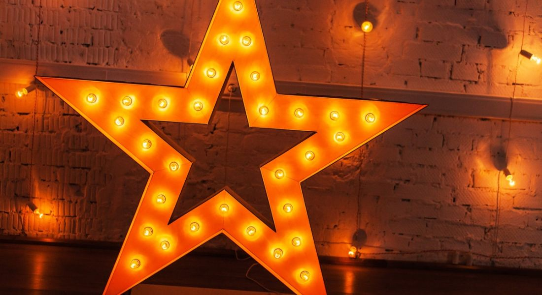 A glowing star against a background with a number of yellow lights symbolising making your CV shine.