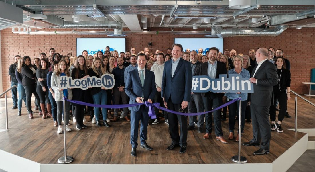 Large group of people at a ribbon-cutting ceremony at a tech company in Dublin.