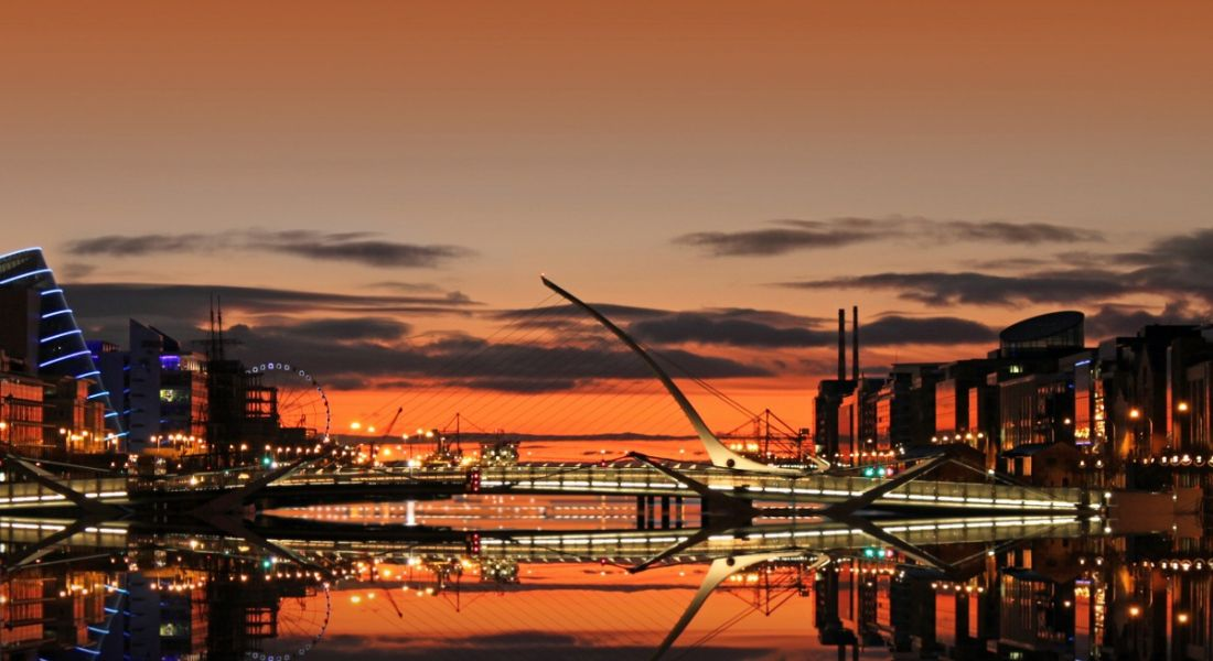 View of Dublin docklands and the Samuel Beckett bridge at sunrise.