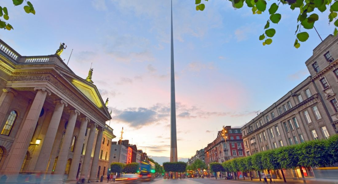 View of Dublin city, O'Connell St and the Spire monument against the backdrop of a summer sunset.