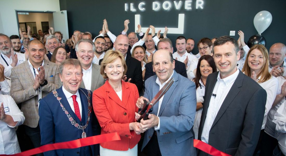 Dignitaries and staff at the opening of a new plant in Cork cutting a ribbon.