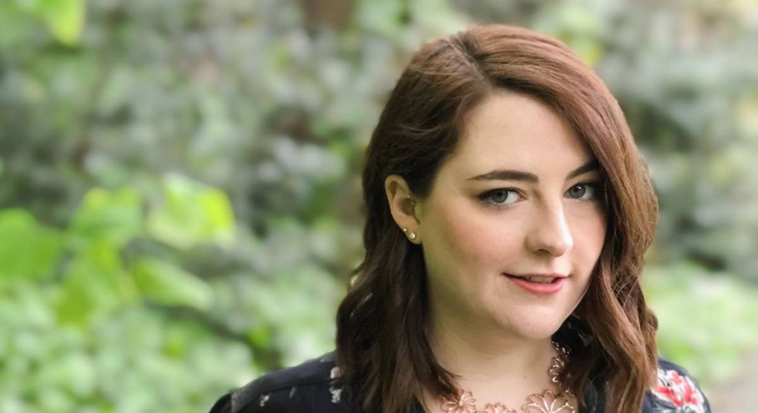 A close-up headshot of a young woman with brown hair. In this article, she discusses her career change.