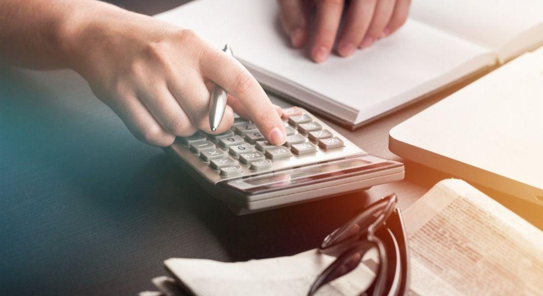Accountant using calculator to do payroll.