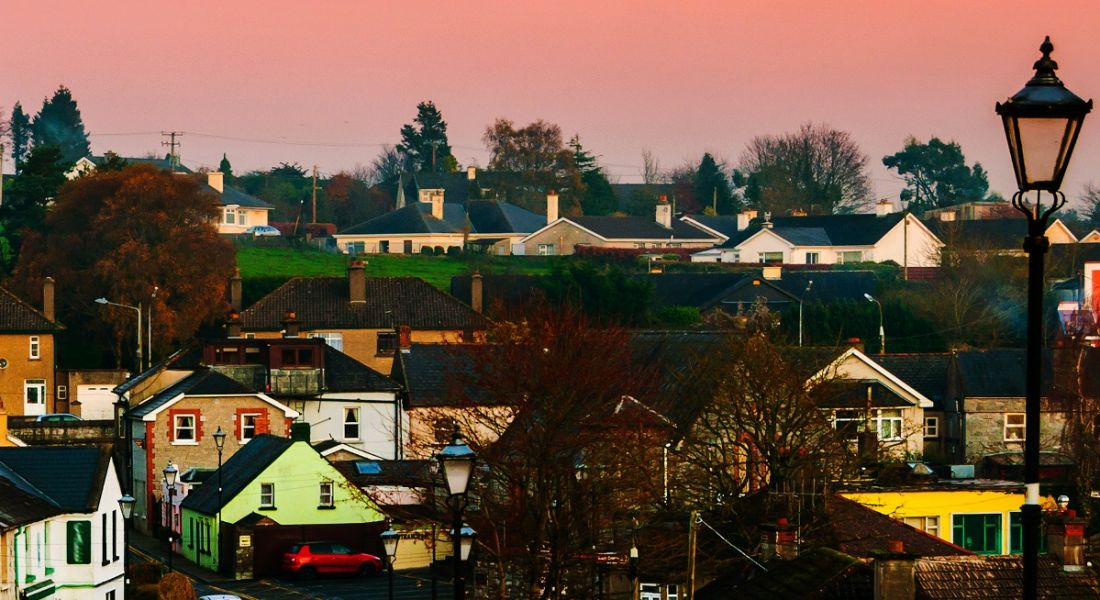 skyline image of Cashel, Tipperary, against a sunset.