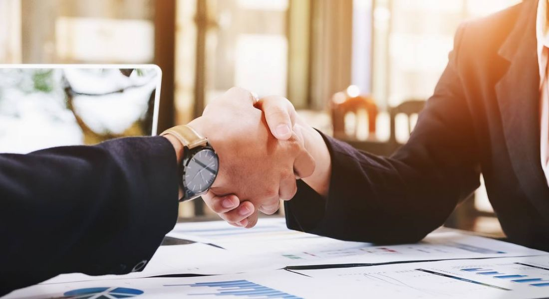 Business man and woman handshake, symbolising respect when letting staff go.