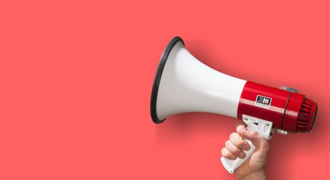 Image of a megaphone against a pink background.