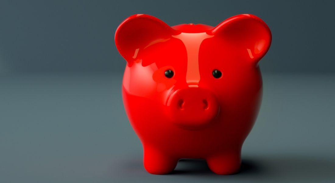 A red piggy bank against a grey background, representing a jobseeker's salary expectations.