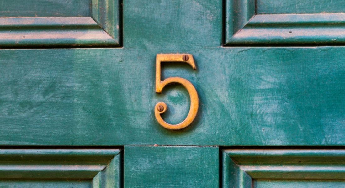 A gold number five on a dark green door representing the number of reasons Inspirefest will help grow your career.