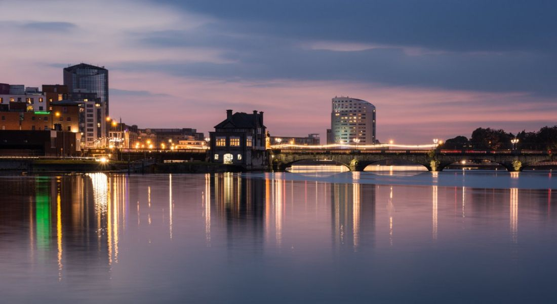View of city skyline next to body of water in Limerick, Ireland.