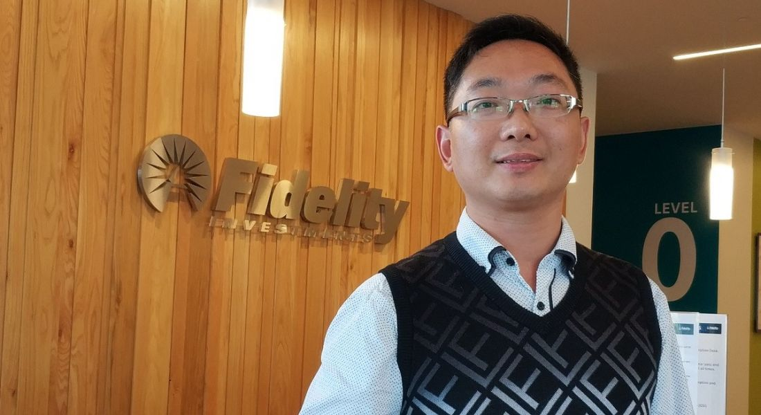 Headshot of a man looking into the camera in the reception of Fidelity Investments.