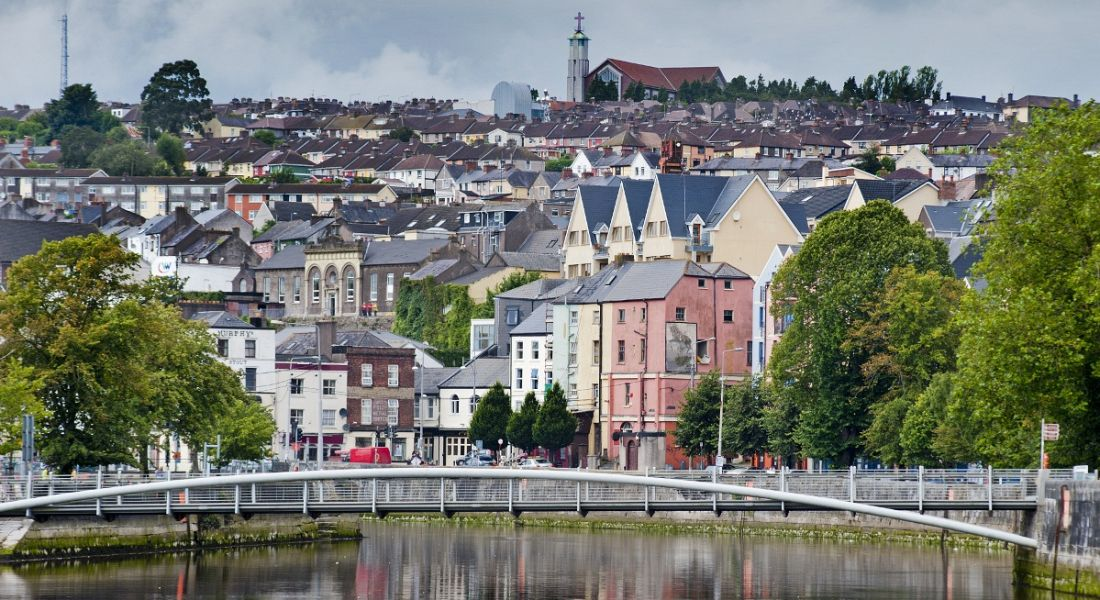 Cork cityscape with colourful buildings and a bridge across the river.