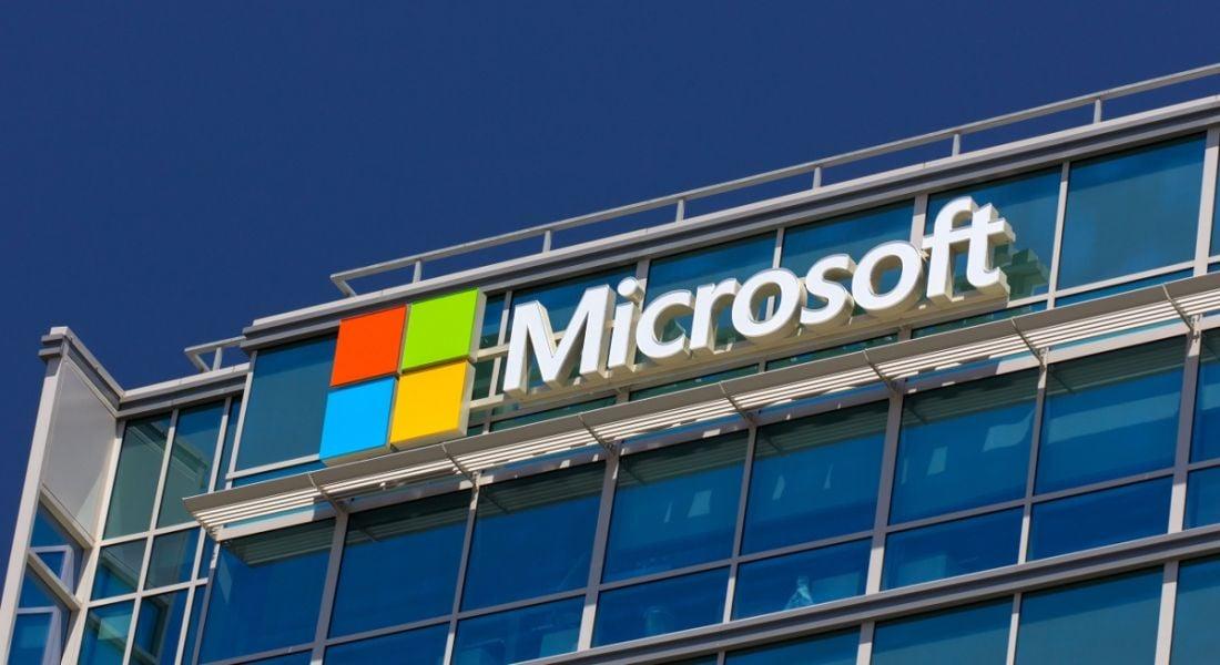 Microsoft corporate building against a blue sky.
