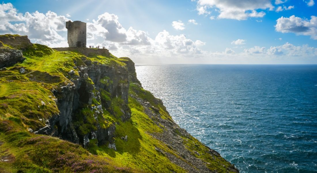 Sun shining on the Cliffs of Moher in Clare, Ireland.