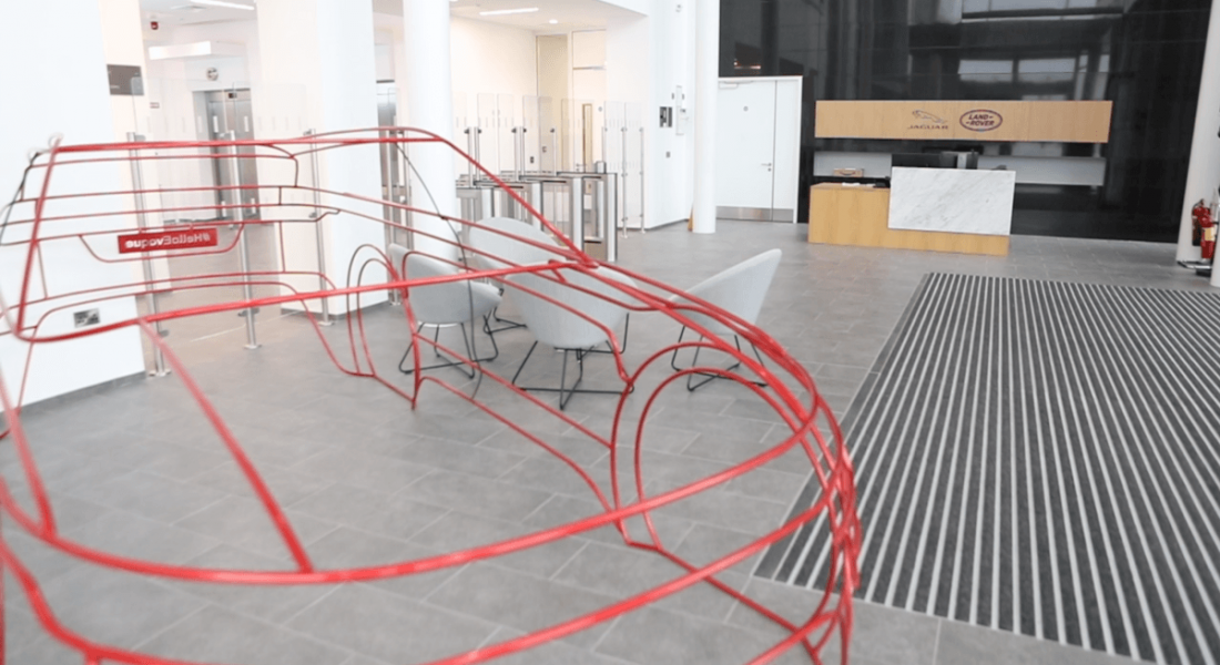 A red wire model car in the lobby of JLR Shannon.