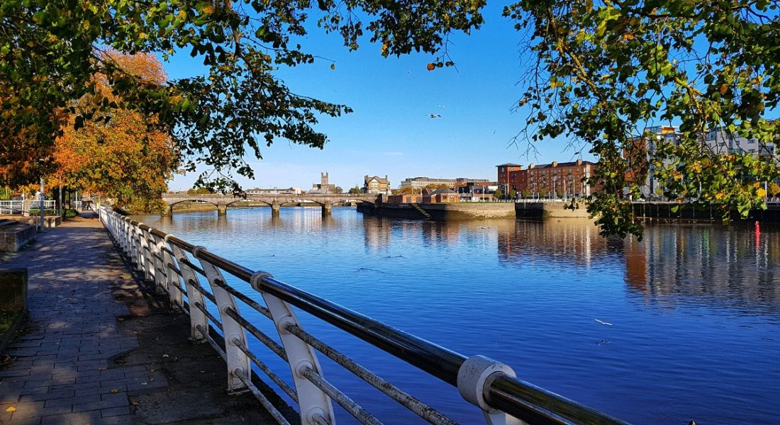 Limerick city skyline by the River Shannon on a sunny day.