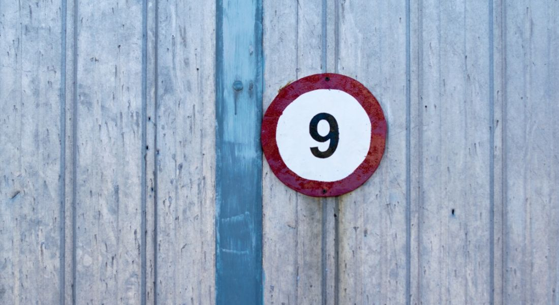 Number nine on an outdoor signpost.