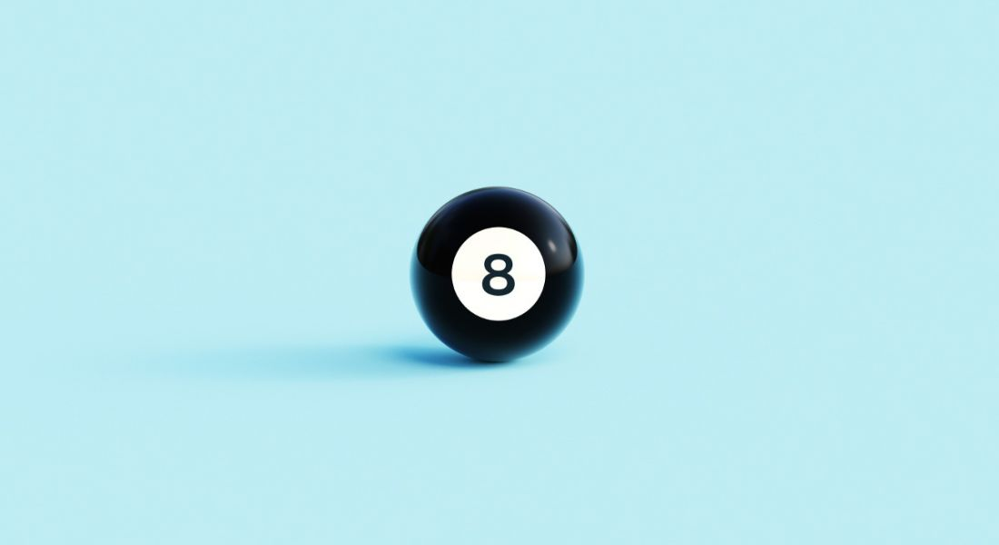 Black magic eight ball against a pale blue background.