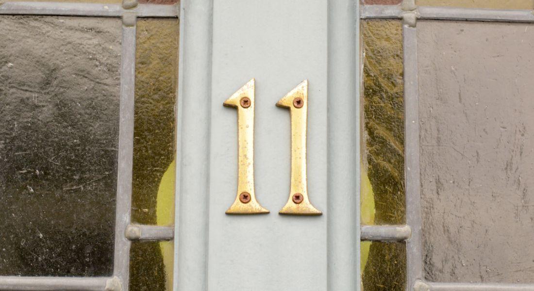 Number 11 on a grey front door.