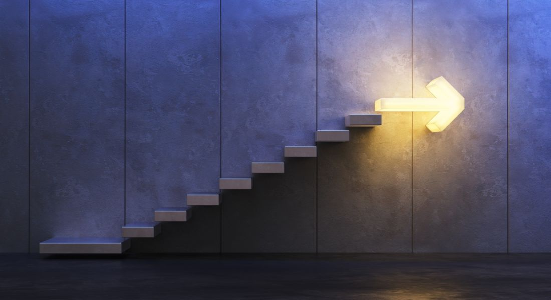 Stairs going upwards with an arrow-shaped light at the top.