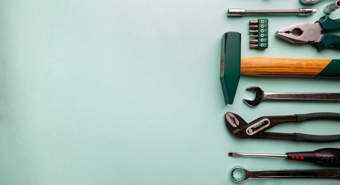 Set of tools against a blue background.