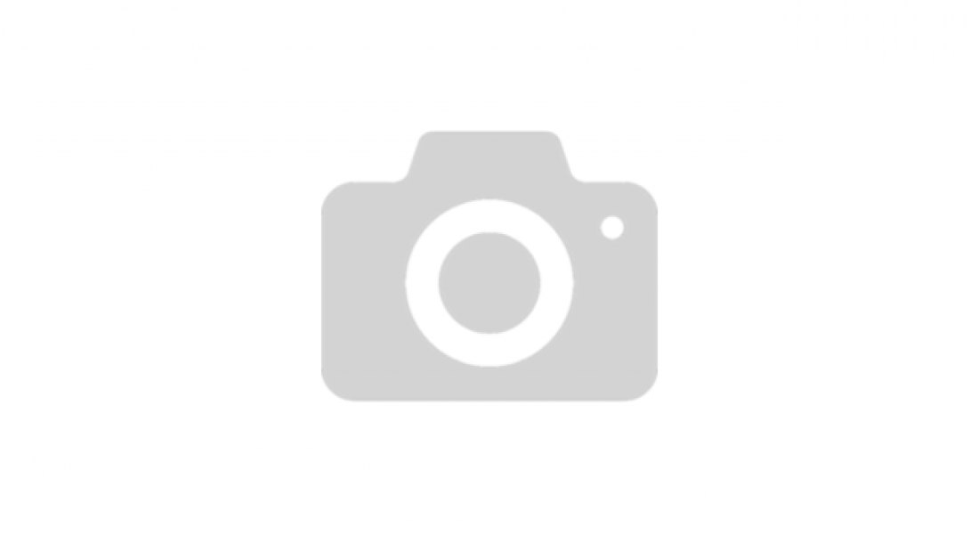 A bright orange front door with a gold number 10 nailed to it.