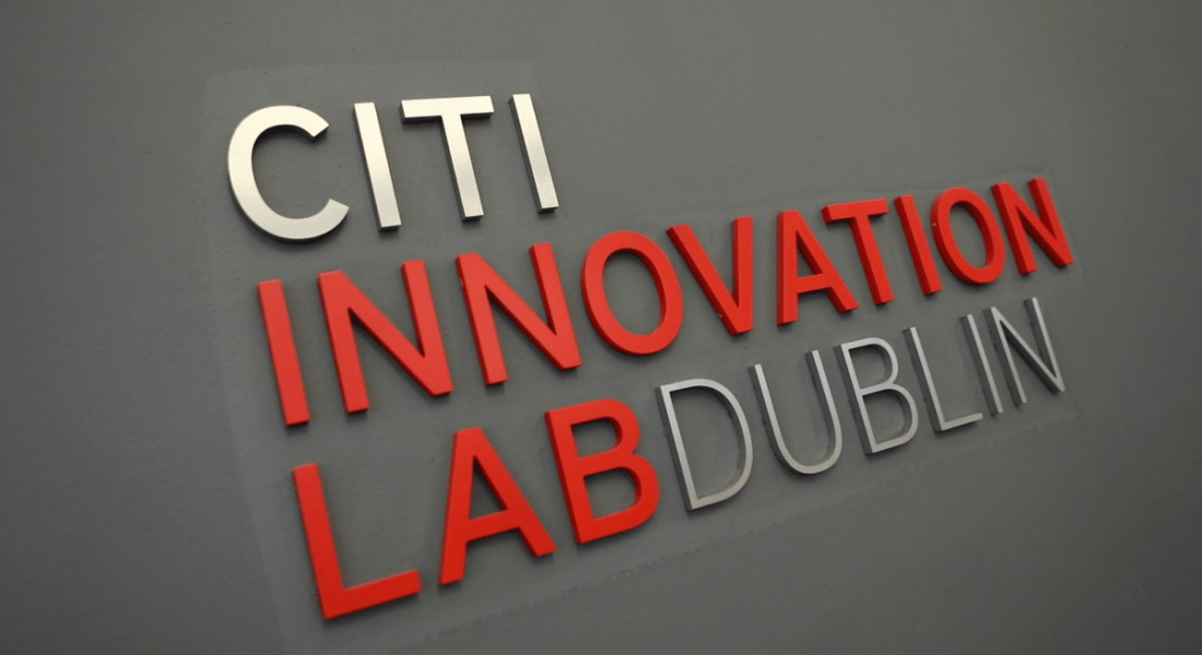 A sign for the Citi Innovation Lab Dublin is in white and red font on a grey wall.