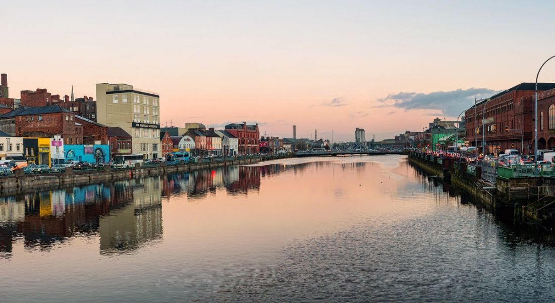 The River Lee in Cork city against an evening sky as the sun is setting.