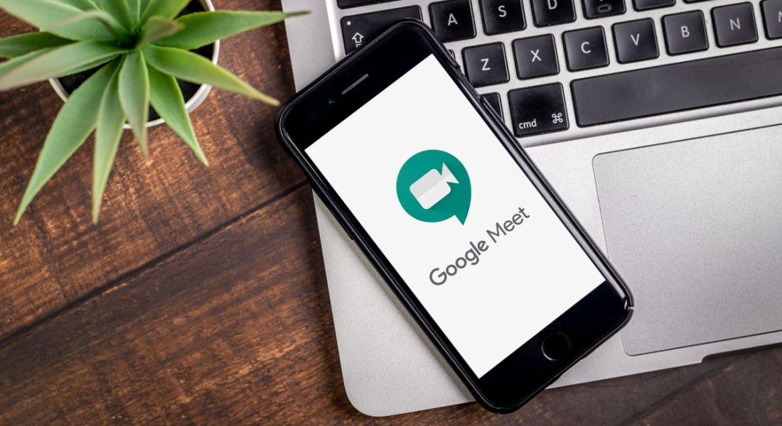 Smart phone showing Google Meet app logo.