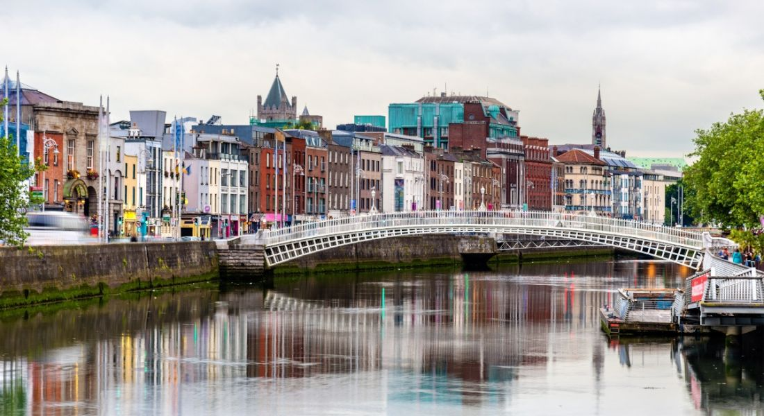 A view of the River Liffey in Dublin city centre with the Ha'penny Bridge in the background.