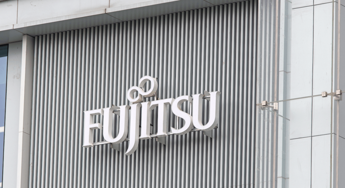 The Fujitsu logo on the front of an office building.