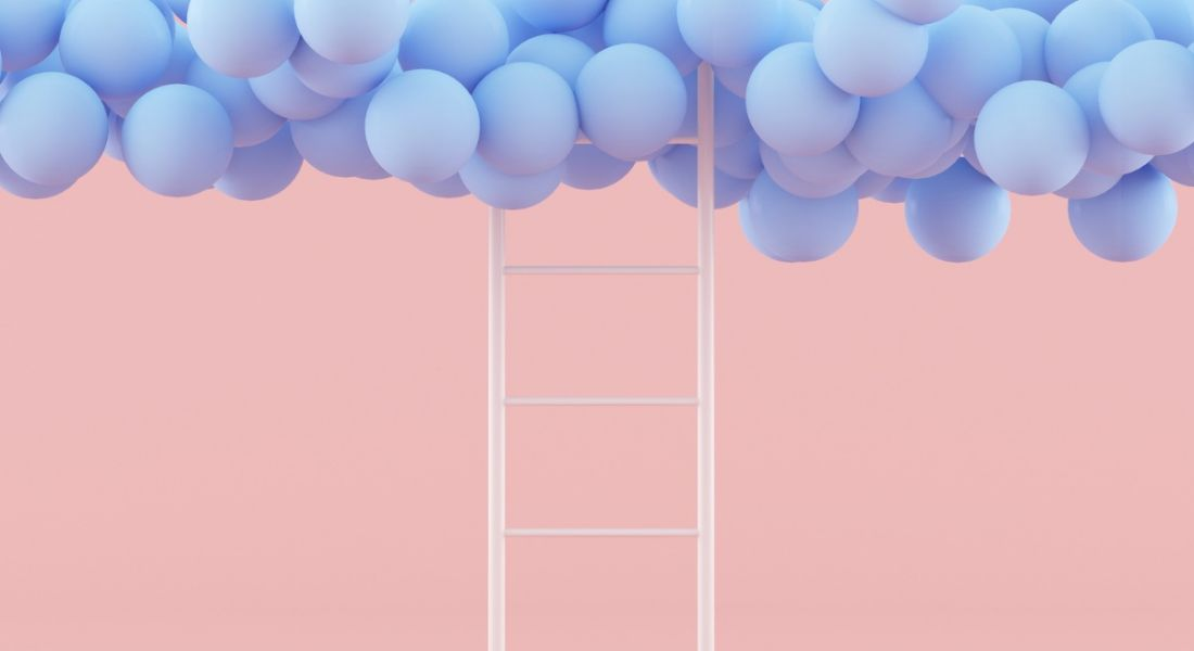 White ladder on a pink background leading up to blue balloons, symbolising moving up to the future of work.