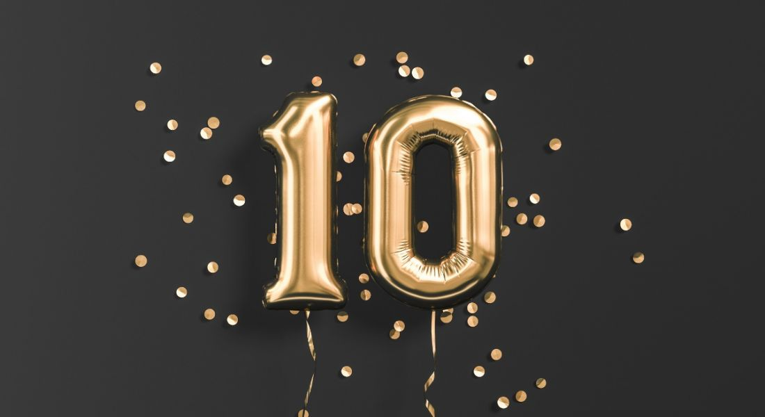Number 10 gold foil balloons on a black background.