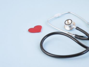 Stethoscope and red heart on a blue background.