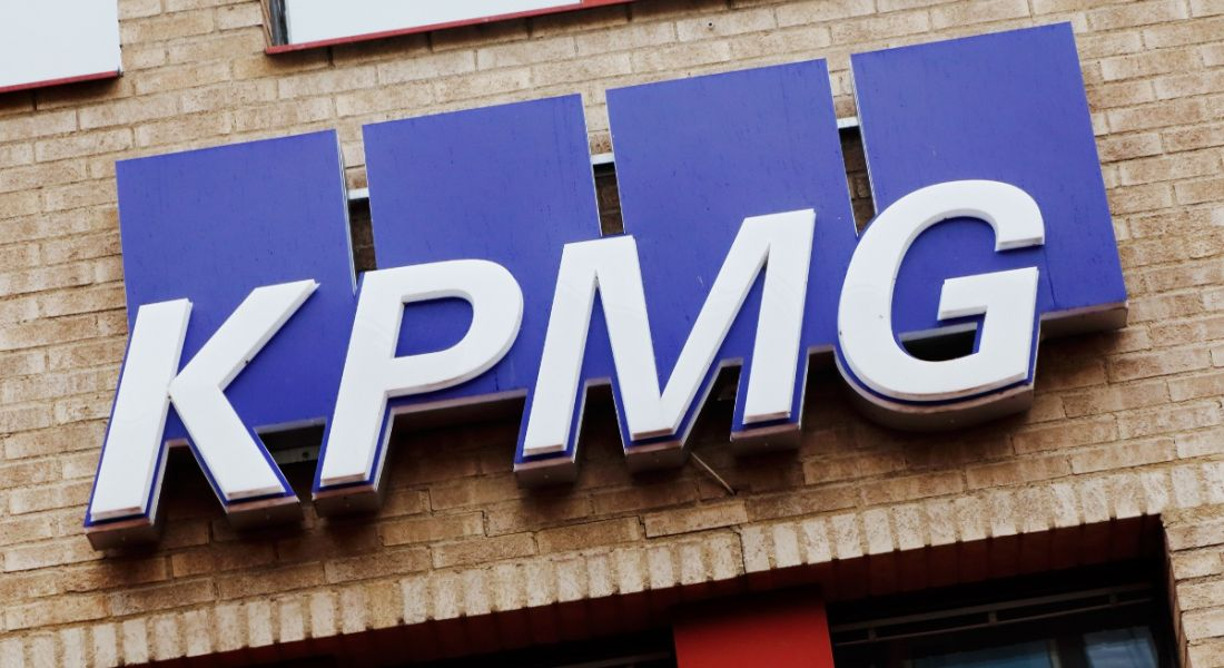 Close-up of the KPMG logo and sign on one of its office buildings.
