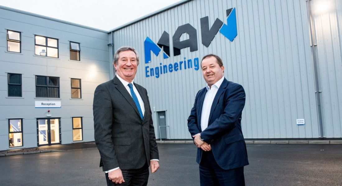 Two professional men are standing outside the MAW Engineering offices in Antrim, looking into the camera.