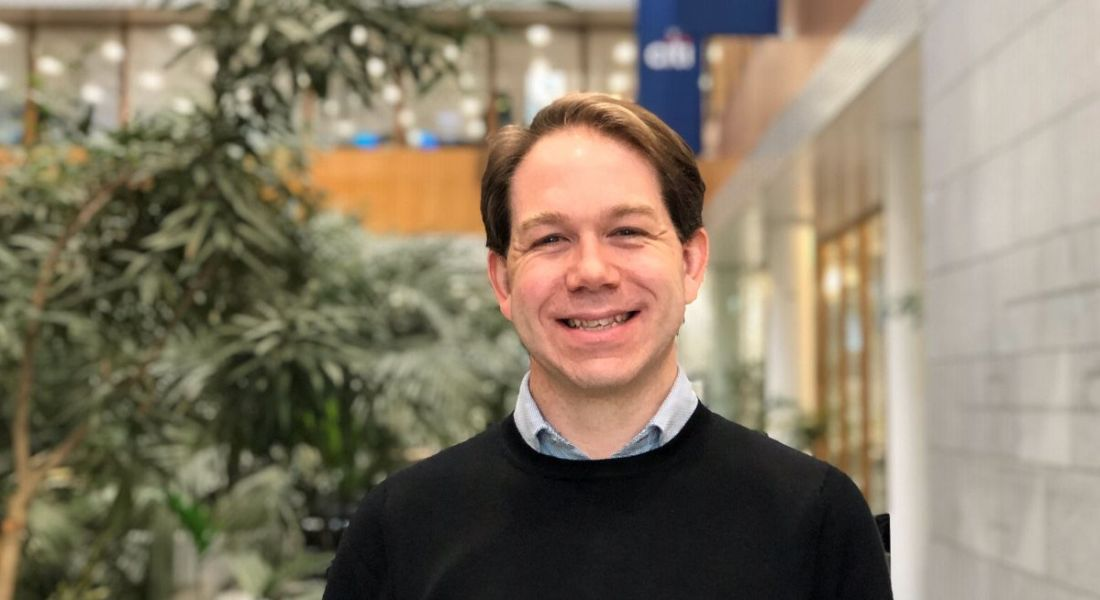 Matthew Beckingham, data scientist at Citi, is smiling into the camera at the company's offices in Dublin.