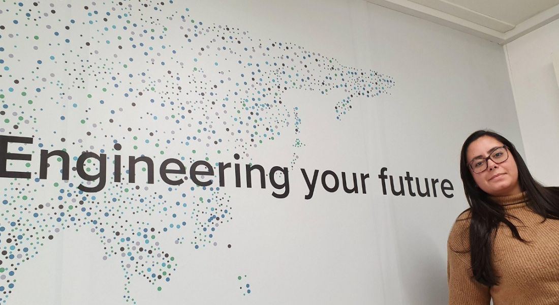 Luiza Brack is standing in front of a wall that says 'Engineering your Future'.