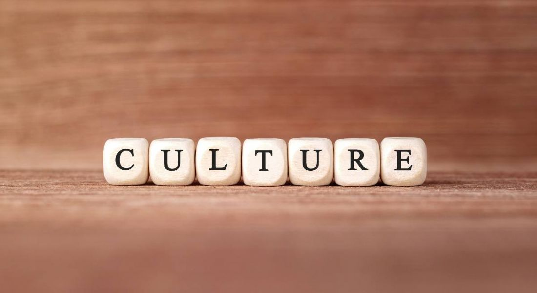 The word 'culture' spelled out with wooden building blocks.