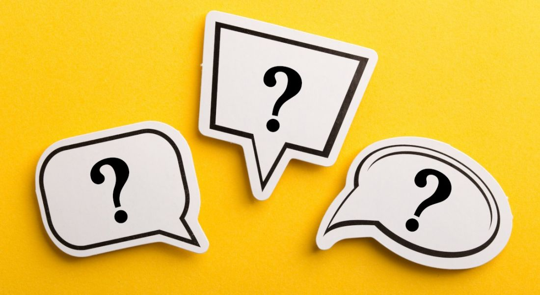 Three differently shaped speech bubbles with question marks inside, against a yellow background.