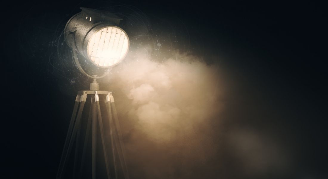 Glowing spotlight against in a dark room.