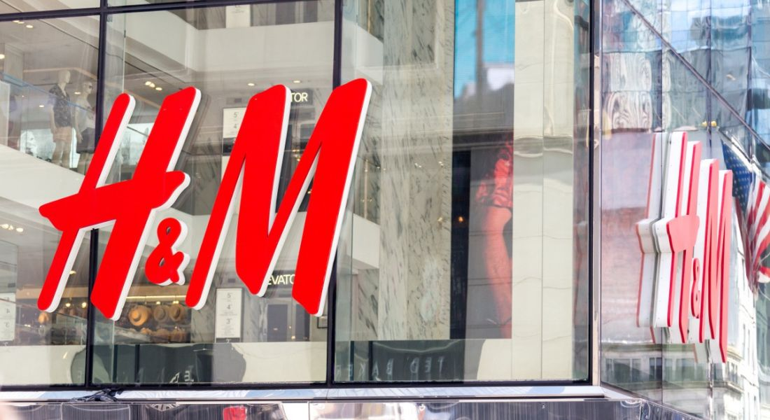 H&M logo on glass windows of store in New York City.