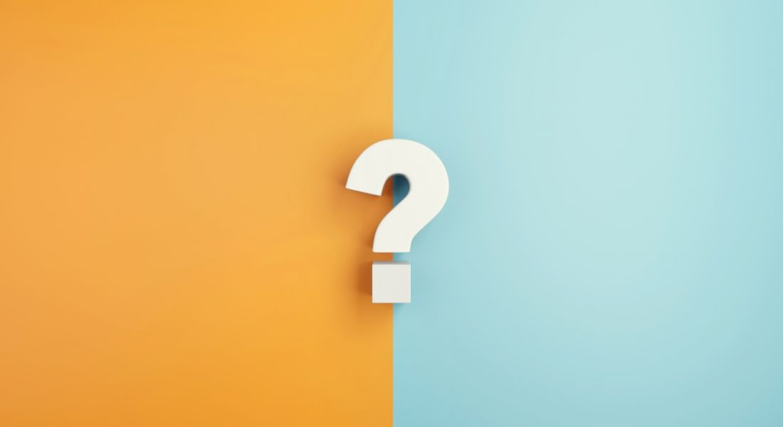 White question mark against a half orange and half blue background.